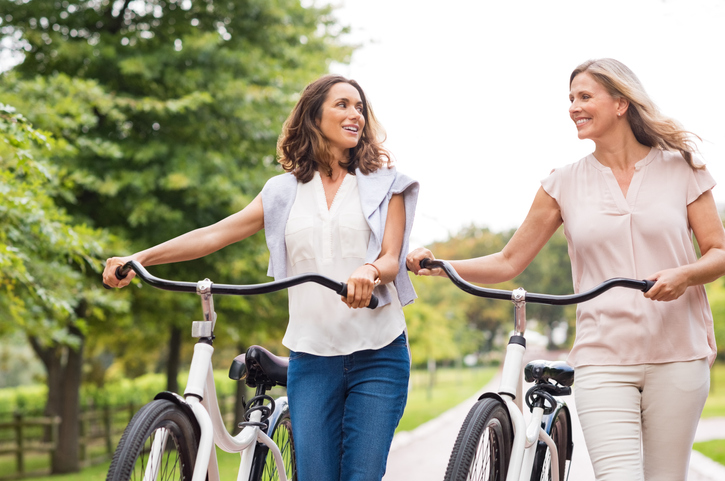 Female couple with bicycles