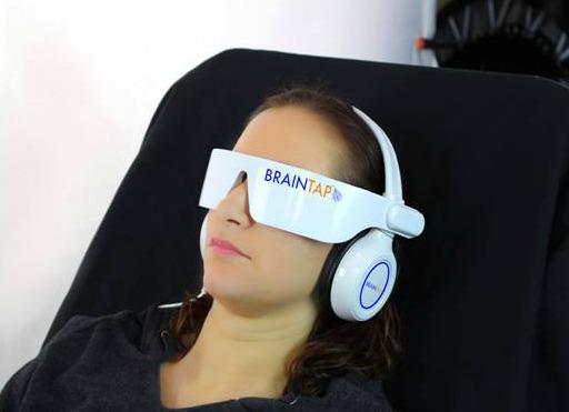 Woman wearing BrainTap headset and headphones