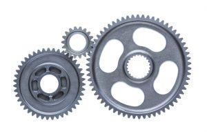 Three metal gears interlocking
