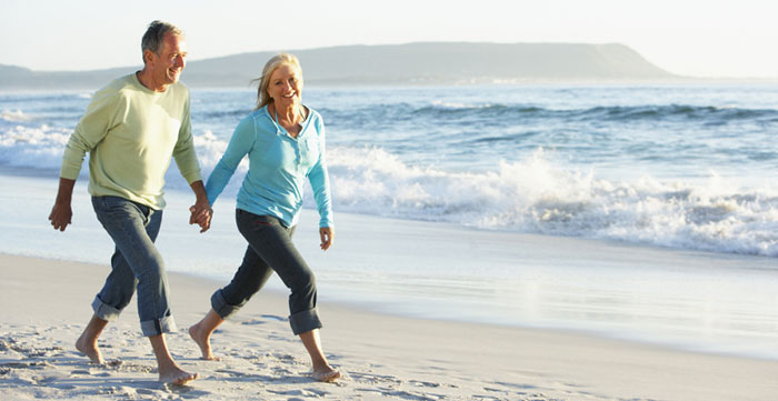 Man and woman walking on the beach
