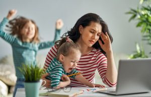 Stressed-out mom with two screaming kids
