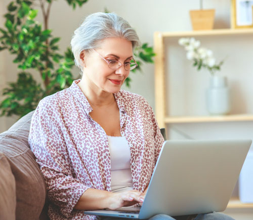 Older lady on telehealth call on laptop